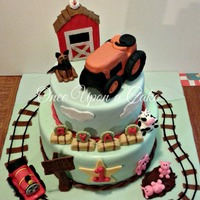 "A Cake Based On Ryans Favorite Toys The Orange Tractor Being His Fave He Turned One And I Made This Cake For Him 12 Bottom 9 Top Ch A cake based on Ryan's favorite toys, the orange tractor being his fave! He turned one and I made this cake for him! 12"" bottom,..."