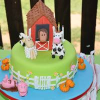 Barnyard Cake single tier with green and blue vanilla sponge