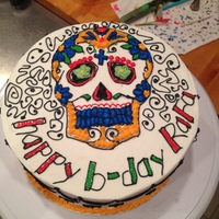 Dia De Los Muertos Yellow cake with chocolate mousse filling. Iced with vanilla buttercream. I made this for my friends birthday. They are not fans of fondant...