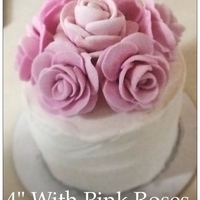 Petite Roses 4 inch round vanilla cake with pink fondant roses, buttercream icing, and a strawberry whipped cream filling