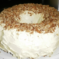 Butter Pecan Bunt Cake Butter Pecan Bunt Cake with butter cream icing covered with pecan pieces.