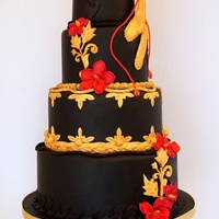 Bird Of Paradise Golden hand moulded gumpaste Bird of Paradise perched on top of a completely chocolate wedding cake (I covered it with SatinIce dark...