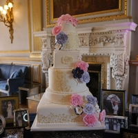 Swirls & Roses Wedding Cake This six tier cake was created for a lovely couple getting married in a grand hall near Liverpool, UK, The tiers were in ivory with varying...
