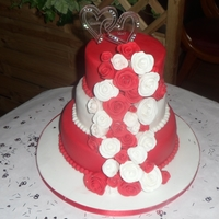 Ruby Wedding Anniversairy Cake   10,8 and 6 3 tier sponge cake covered in hand made roses from sugarpaste