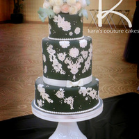Gray, Vinatge Lace, And Wafer Roses Wedding Cake This cake features lace applique and a bouquet of Confectioner's wafer roses. 34 roses in all sprinkled with some brunia and...