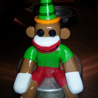 Sock Monkey Cake Topper. made out of rice crispy treats. and covered in fondant.