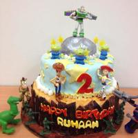 "Toy Story Birthday Cake 8"" chocolate cake over 10"" white cake both covered with white chocolate buttercream and satin ice fondant. The figures are store..."