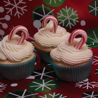 Vanilla Peppermint Cupcakes Vanilla peppermint cupcakes topped with peppermint buttercream and a mini candy cane