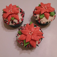 Eggnog Cupcake Decorated With A Christmas Poinsettia Eggnog cupcake decorated with a Christmas Poinsettia
