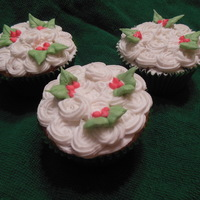 Eggnog Cupcake Topped With Vanilla Butter Cream Rosettes And Holly Eggnog cupcake topped with vanilla butter cream rosettes and holly