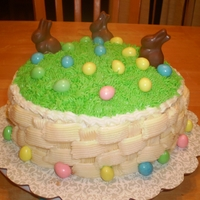 Easter Cake Easter cake made with a basket weave, chocolate bunnies and reeses eggs.