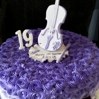 Violet Violin Cake With Hand Crafted Toppers Violet violin cake with hand crafted toppers.