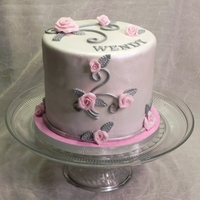 Roses On Your Birthday  Cake is gluten free chocolate, filled with chocolate buttercream and chocolate syrup, dammed and covered in dark chocolate ganache. Fondant...
