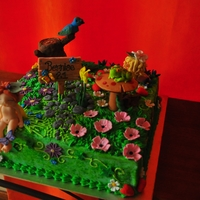 Enchanted Fairy Garden Sponge cake covered in gum paste decorated with 3D charactes made with gum paste