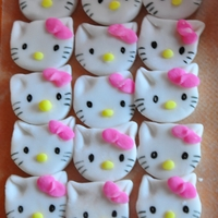 Hello Kitty Hello Kitty cupcake toppers made with gumpaste. No mold used