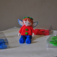 Boy Angel 3D Boy Angel made with gum paste as a cake topper for a Christening cake
