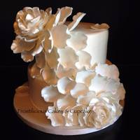 "White Petals   Wedding cake. 10"" & 8"" vanilla cakes with vanilla buttercream filling. Covered with fondant and gumpaste roses/petals."
