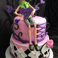 Monster High Cake & Cupcakes 9 and 7 inch strawberry and vanilla cakes. Cakes covered in fondant. Figurine provided by my friend. All other decorations made out of...
