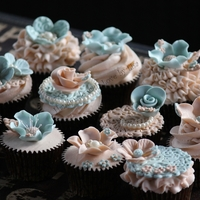 Vintage Cupcakes   These lovely cupcakes are a delicate mix of soft colours and delicious buttercream icing.