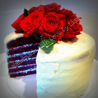 Red Velvet Cake Layered With Cream Cheese Frosting   This delicious cake is topped with beautiful fresh red roses.