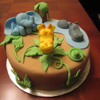 Jungle Themed Cake   3rd Cake! Had a lot of fun with this one!It's a 3'' X 8'' Vanilla Cake with Vanilla Buttercream Icing