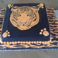 Tiger Cake   Cake made for the hometown high school volleyball team. Tiger is a buttercream transfer.
