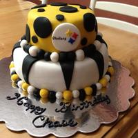Steelers Cake   Steelers Cake made with yellow cake and fondant. Top cake is two six inch and bottom is two 9 inch.