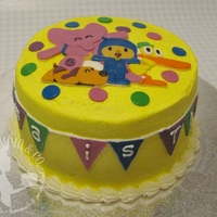 "Pocoyo Birthday Cake Buttercream cake with fondant accents. The pendants around the cake say, ""Emma is Three"""