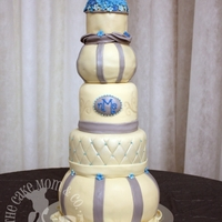 Elegant Wedding Cake  This is a wedding cake made by our baker Emily. This is the tallest cake ever accomplished by our company, and we can thank Cake Stackers...