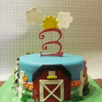 Barnyard Birthday Cake Small fondant covered cake with a cow, horse, sheep, pig & barn.