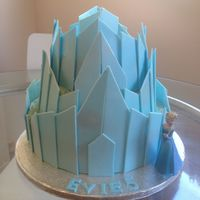 Frozen - Elsa's Ice Castle My first tiered cake. 3 cakes 10-8-6 with fondant panels.