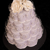 Petal Shaped Wedding Cake Succulent Flowers Top An Oriental Stringwork Inspired Cake This Won 3Rd Place In Wedding Beginners At That Takes... Petal shaped wedding cake. Succulent flowers top an oriental stringwork inspired cake. This won 3rd place in wedding beginners at That...
