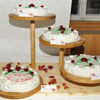 White Wedding Cakes With Dark Red Fondant Roses White wedding cakes with dark red fondant roses filled with different delicious flavours like baileys ganache and pinapple-coconat-cream