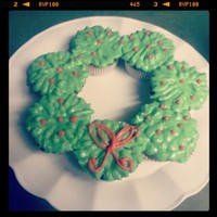 Christmas Wreath Made From Cupcakes Decorated With Cream Chesse Non Crusting Icing Christmas wreath made from cupcakes, decorated with cream chesse non crusting icing