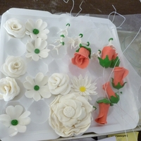 Gum Paste Flowers those flowers were made half fondant and half wilton gumpaste, i made those for my 11th anniversary cake andd im still working on it!