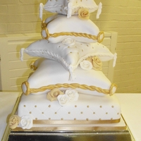 5 Tier Pillow Cake 5 tier wedding cake, bottom tier is fruit, 4th is maderia, 3rd is chocolate, 2nd is vanilla and top tier is vanilla and marzipan. I was...