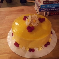 Lemon Daisy Cake Lemon sponge cake with lemon buttercream frostin and gumpase daisies and blossoms