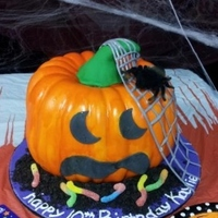 Jack-O-Lantern  Cake is 2 bundt cakes stacked, covered in marshmallow fondant. Stem and face are fondant, and cake board was covered in fondant, too. The...