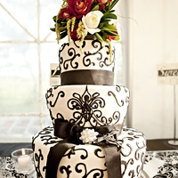 Bedazzling Black And White Want to wow the guests at your wedding? Blast them with a bold black and white stunner! This cake was almost as beautiful as the bride!