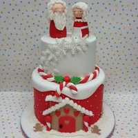 Mr And Mrs Claus I donated this cake to my sons school Christmas fete last week and thoroughly enjoyed making it. Both tiers are chocolate mud cake and...