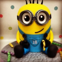 Minion!!!!  I loved creating this cake!!! I hadnt done a carved cake in quite a while so it had me a little nervous but loved how it turned out and...