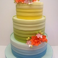Rainbow Colours Wedding Cake For A Bride Having A Rainbow Themed Wedding Bottom Tier Is A Zesty Lemon Cake Laced With A Lemon Syrup Lem Rainbow Colours Wedding cake for a bride having a rainbow themed wedding. Bottom tier is a zesty lemon cake laced with a lemon syrup, lemon...