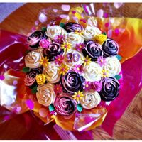 Cupcake Bouquet For a 90th birthday party.Chocolate Raspberry and Lemon cupcakes!