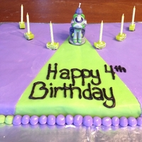 Buzz Lightyear & Aliens Birthday Cake My second fondant cake ever made:On one side the vanilla cake is green and the other purple with buttercream icing and green and purple...