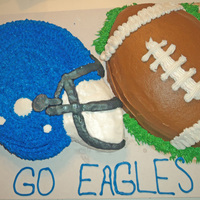 Football Helmet And Football Cake All Decorated In Buttercream For The Local High School Team Football helmet and football cake, all decorated in buttercream for the local high school team.