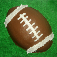 Football On A Grass Field Cake Decorated In Buttercream Football on a grass field cake. Decorated in buttercream.