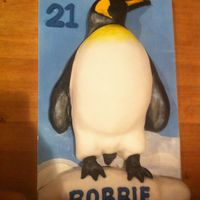 Penguin 21st birthday cake - carved chocolate cake penguin with fondant icing.