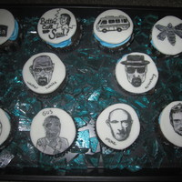 Breaking Bad Cupcakes  Chocolate cupcakes, strawberry filling, butter cream frosting, hand painted images on fondant pieces, and home made rock candy to really...