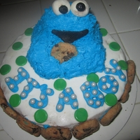 Cookie Monster Baby Shower Cake   This is a baby shower cake featuring cookie monster (sculpted in cake) and cookies. This is a butter cream cake.