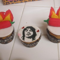 These Cupcakes Were For Someones Birthday She Is A Big Fan Of The Red Hot Chili Peppers Band So I Made Chili Peppers And Flames Out Of Fo  These cupcakes were for someone's birthday; she is a big fan of the Red Hot Chili Peppers band. So I made chili peppers and flames out...